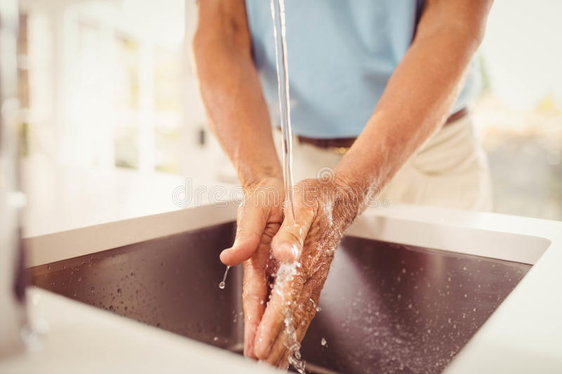 Mid section of senior man washing hands stock photos
