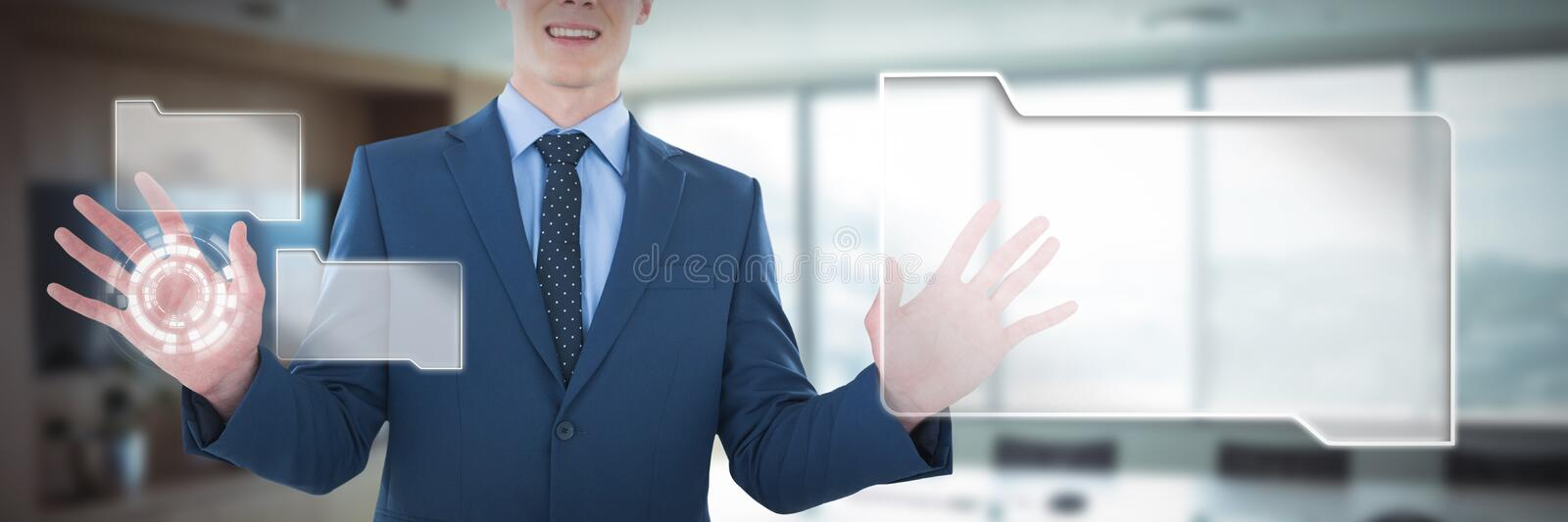 Mid section of smiling businessman using imaginary screen against empty boardroom in office royalty free stock image