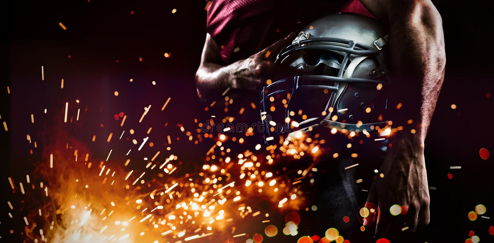 Mid section of sports player holding helmet royalty free stock images
