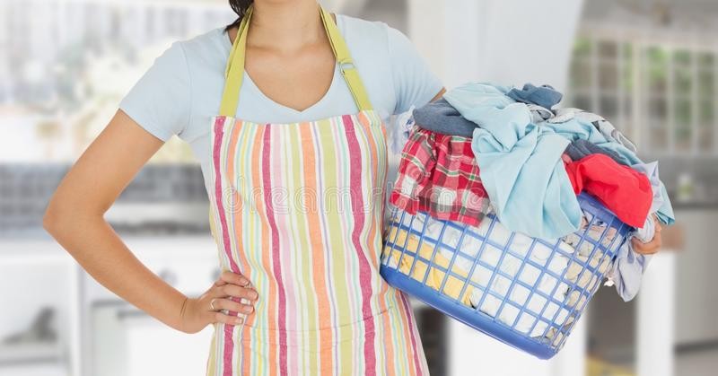 Mid section of woman with apron holding a laundry basket vector illustration