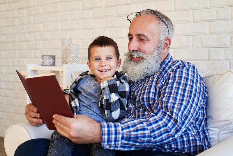 A mid shot of cute grandpa and his grandchild stock images