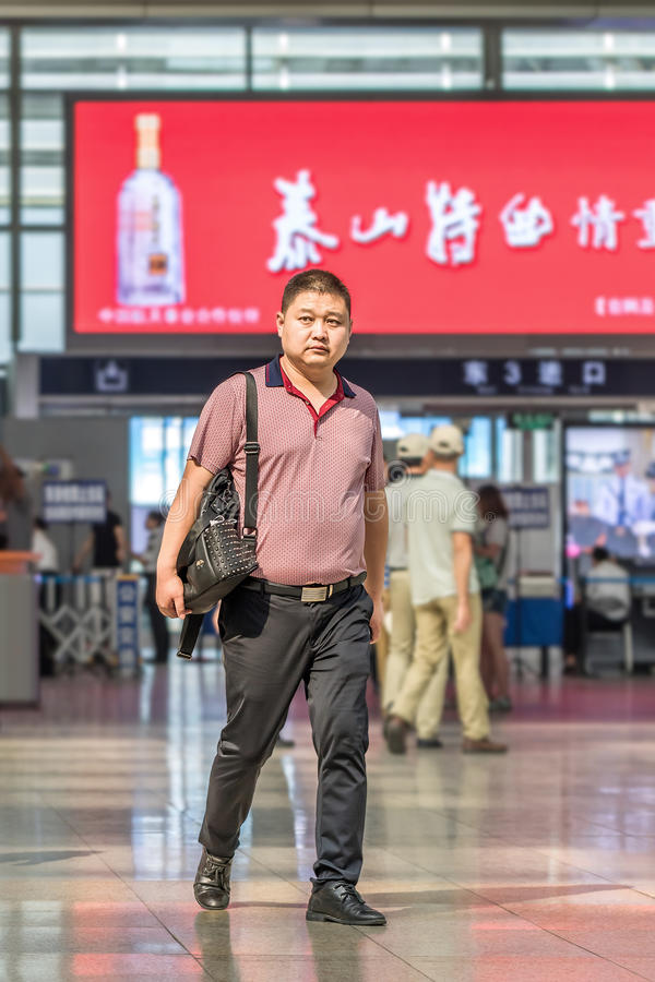 Middel-aged man at Beijing Railway Station South, Beijing, China. BEIJING-MAY 21, 2016. Middle aged man at Beijing Railway Station South, the city`s largest royalty free stock photo