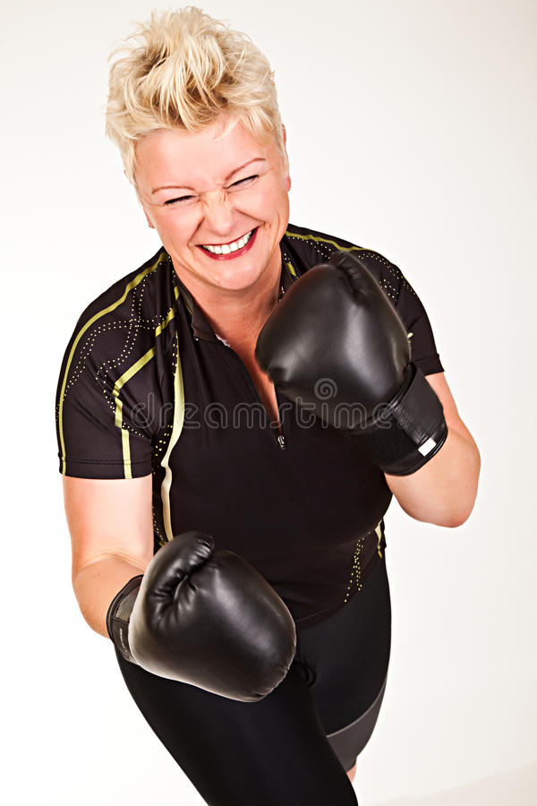 Middelaged Fitness Woman Boxing Wearing Boxing Gloves And Having Stock Photography