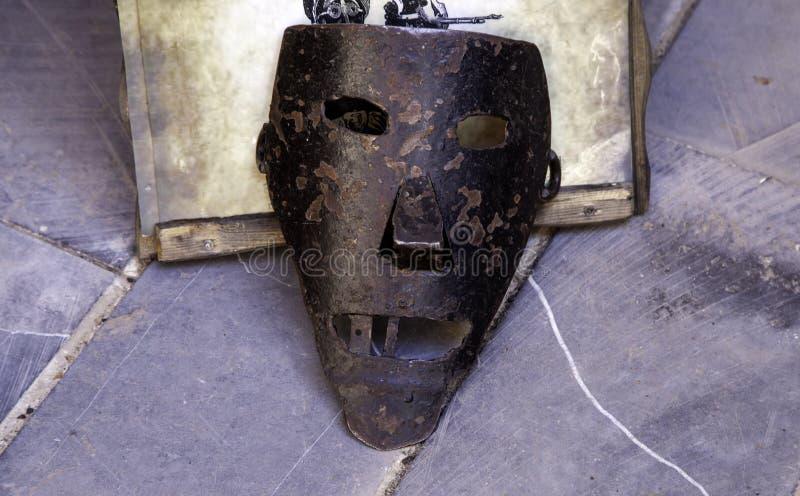 Middeleeuwse martelingsmaskers stock afbeeldingen