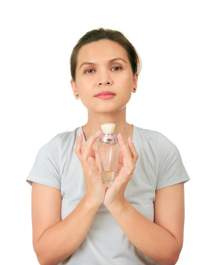 Middle Age Asian Woman With A Fragrance Bottle Royalty Free Stock Images