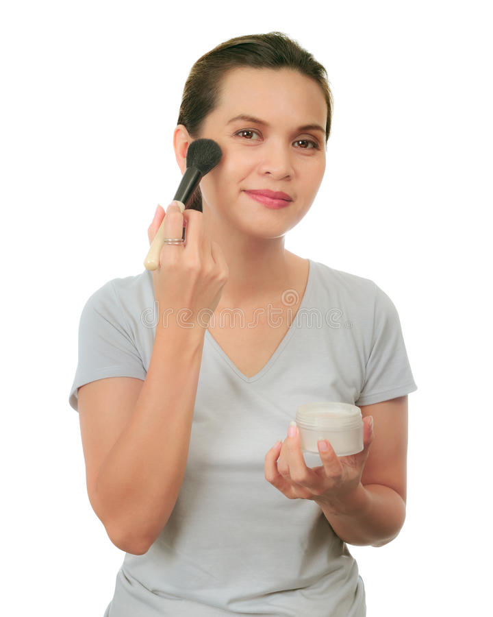 Middle age asian woman with make up brush. royalty free stock photo