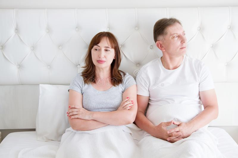 Middle age couple with quarrel problem in relationship in bed at bedroom. Family life. Copy space royalty free stock photography