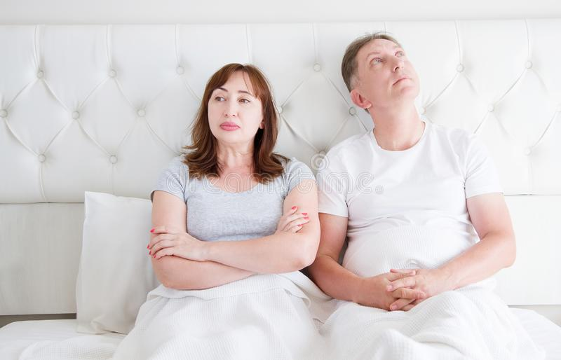 Middle age couple with quarrel problem in relationship in bed. Family life. Copy space stock images