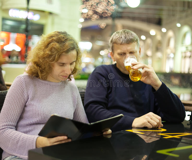 Download Middle Age Couple Reading Menu Card Stock Photo - Image: 26882880