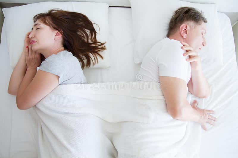 Middle age couple sleeping in bed. Family life in bedroom at home. Healthy sleep time. Selective focus stock photos