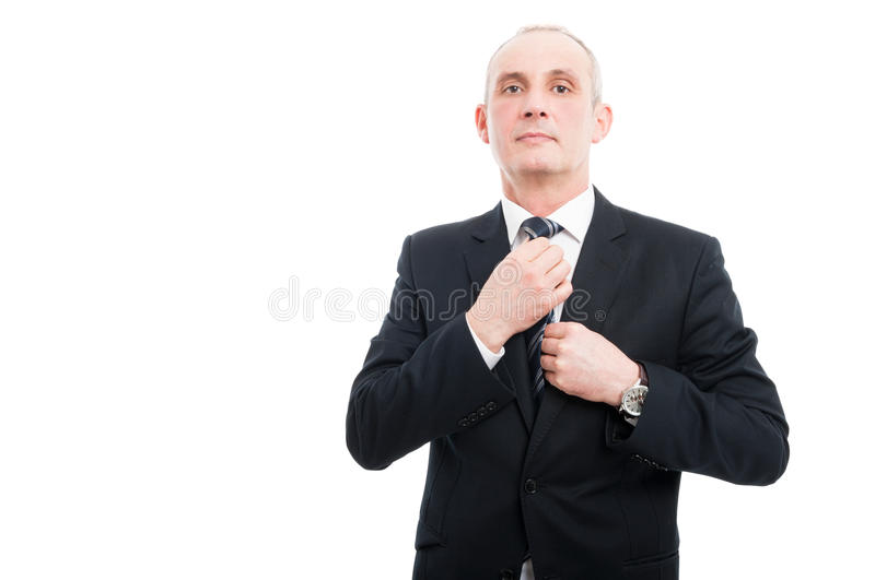 Middle age elegant man adjusting his tie wearing suit royalty free stock photos