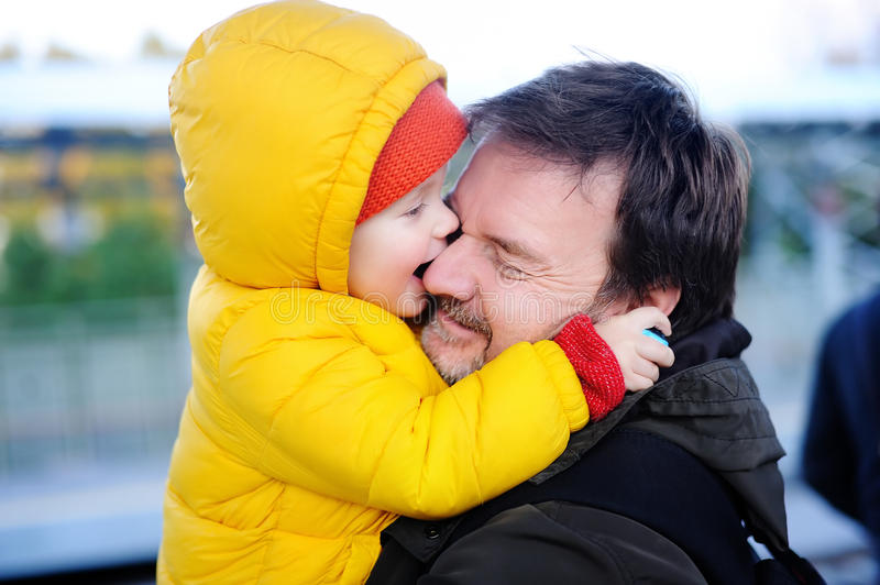 Middle age father with his little son having fun together outdoors stock image