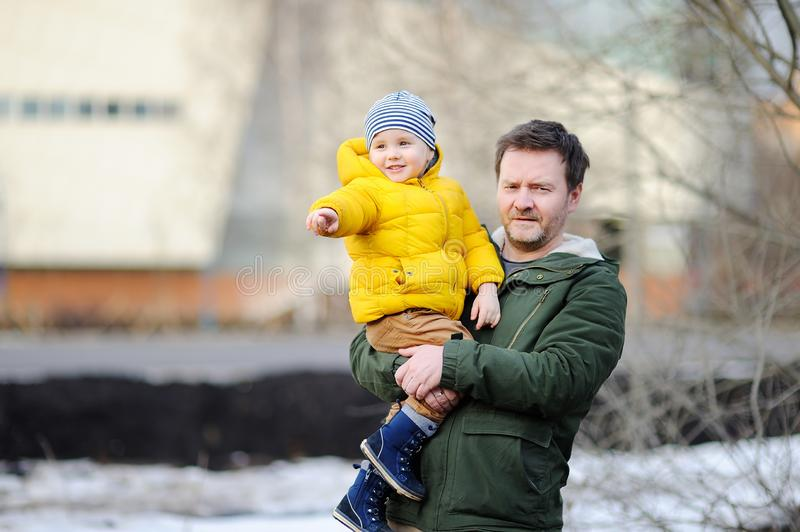 Middle age father with his little son together outdoors royalty free stock image