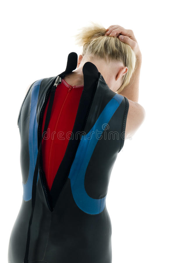 Middle age female tri-athlete in swimming wet suit stock photo