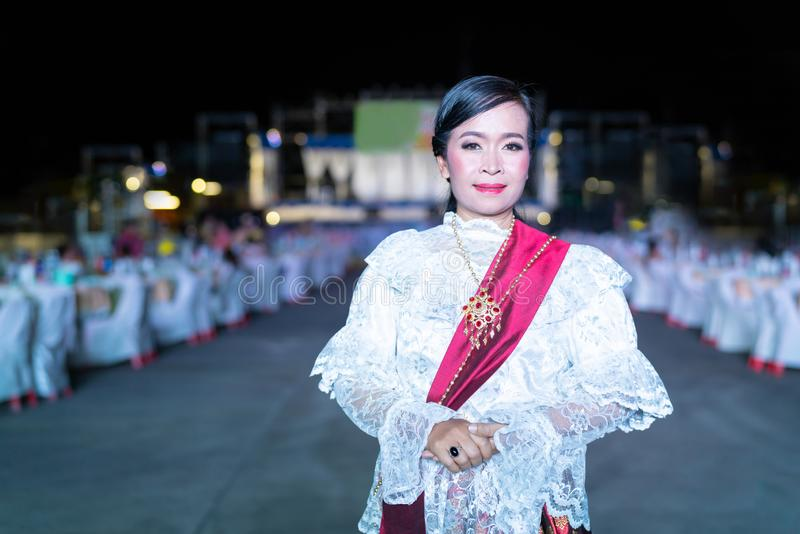 Outdoor Portrait : Thai middle age Lady in vintage original Thailand attire at night party. stock photos