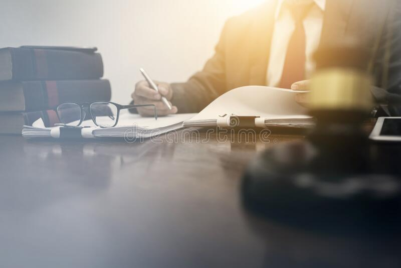 Middle-age of male lawyer working with legislation contract paper in courtroom, attorney justice and law concept stock photography