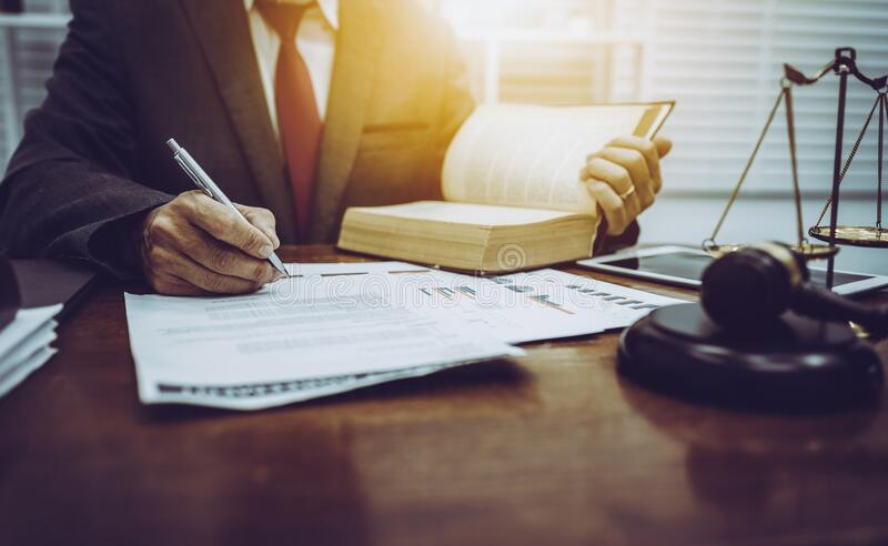 Middle-age of male lawyer working with legislation contract paper in courtroom, attorney justice and law concept royalty free stock photo