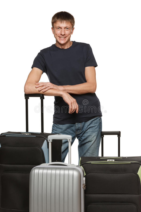 Middle age male standing with suitcases royalty free stock images