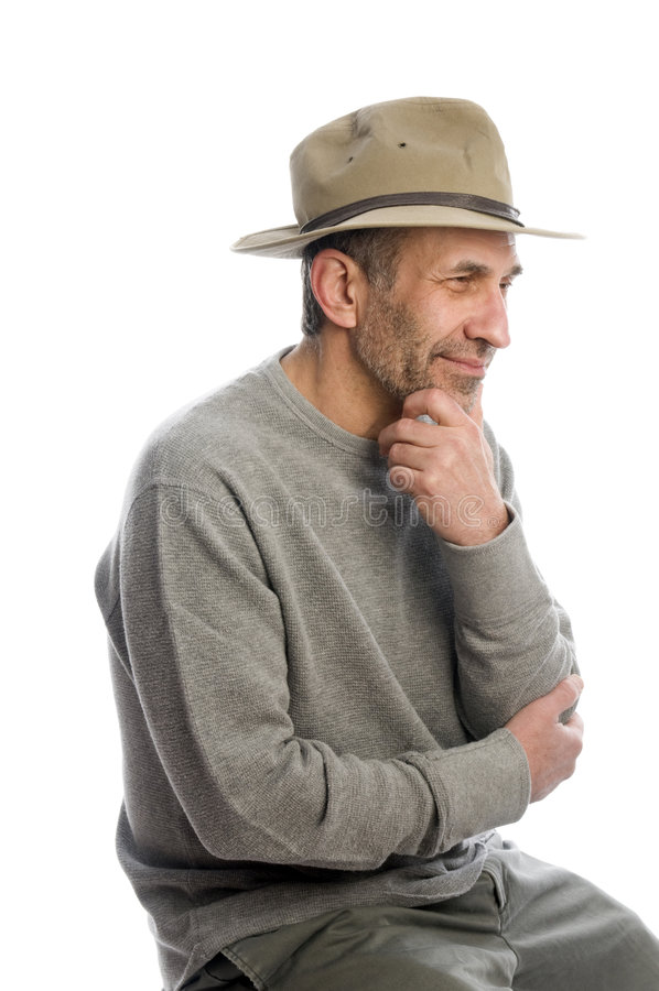 Middle age man adventure hat thinking stock photography