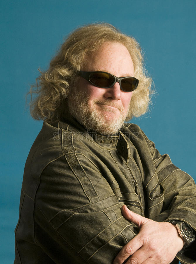 Middle age man leather jacket long hair royalty free stock image