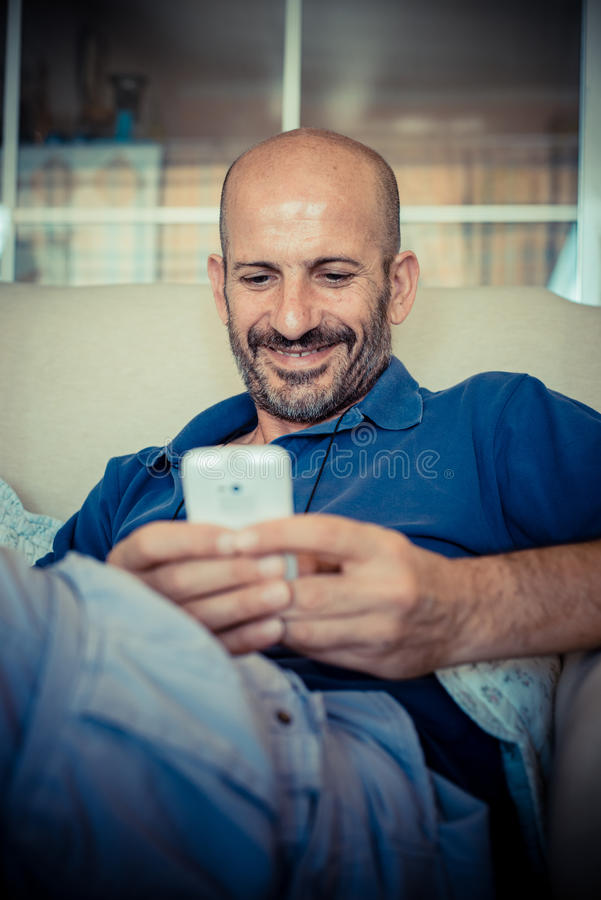 Download Middle age man using phone stock image. Image of life - 33317203