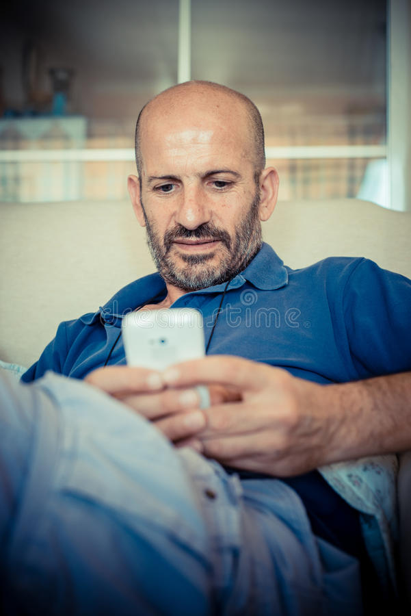 Download Middle age man using phone stock photo. Image of typing - 33317208