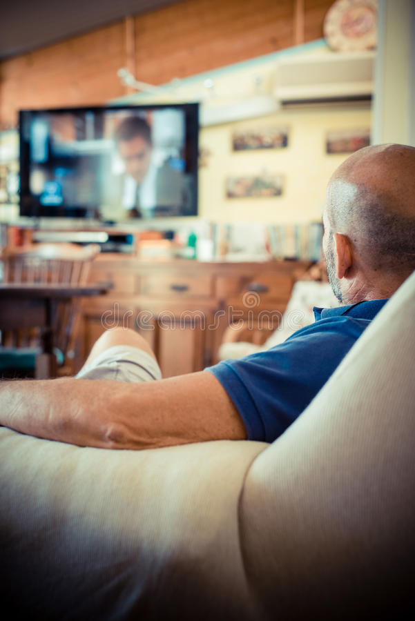 Middle Age Man Watching Tv Royalty Free Stock Photos