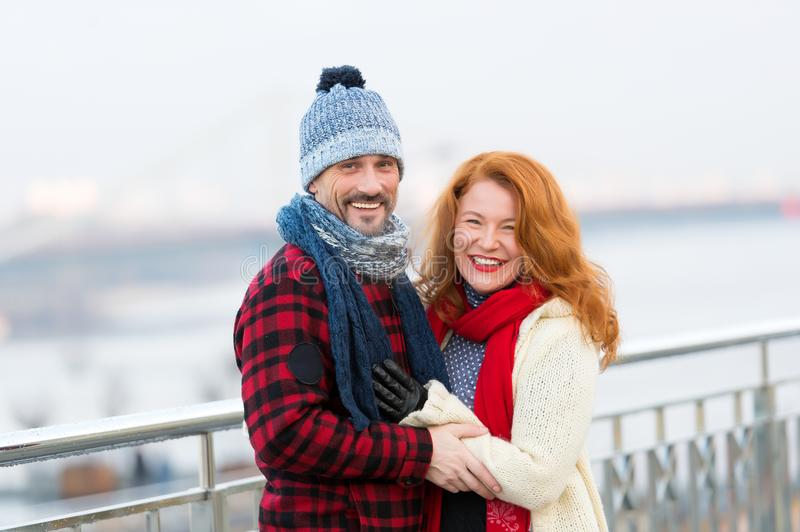 Middle age man and woman smiling on street. Joyful woman and guy. Smiling couple on street in winter wear stock photography