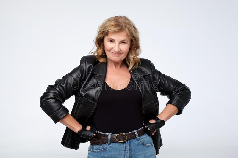 Middle age mature woman wearing fashion leather jacket. stock image