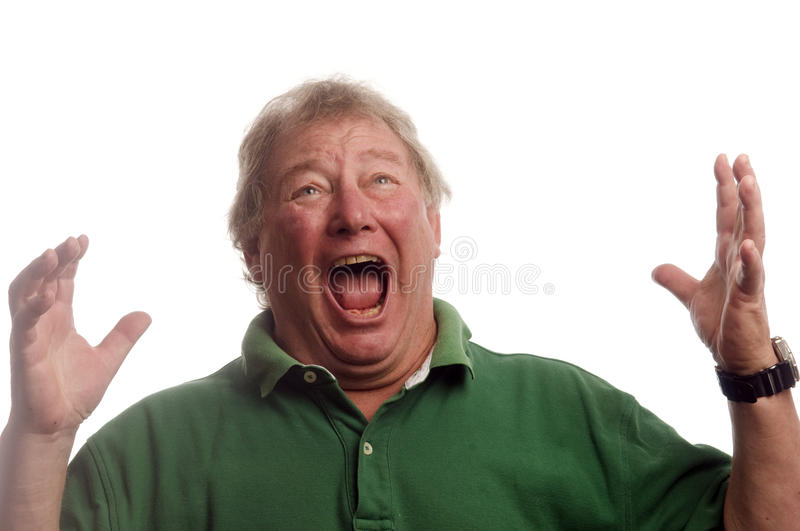 Middle age senior man emotional screaming in shock stock photo