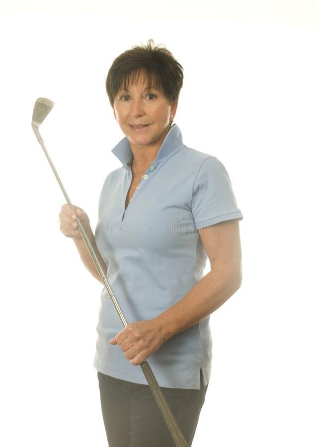Middle age senior woman athlete golf club stock photo