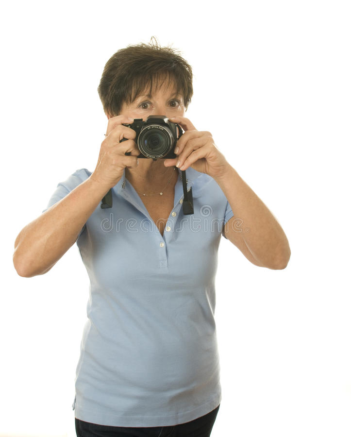 Middle age senior woman with camera taking photo stock photos