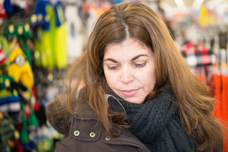 Middle Age Woman Browsing a Store royalty free stock image