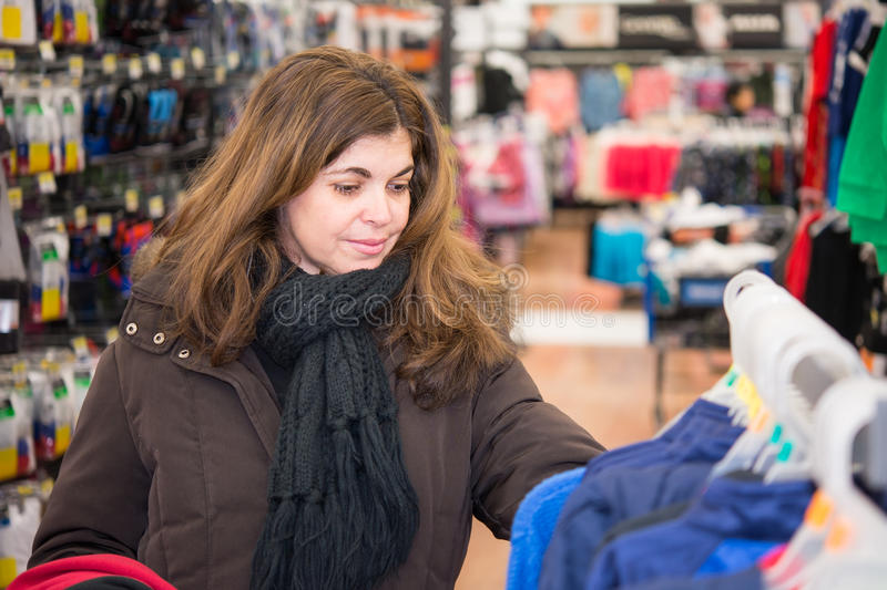 Middle Age Woman Browsing a Store stock images