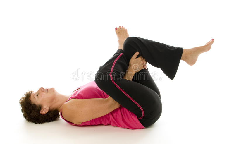 Middle age woman fitness yoga sit up royalty free stock photography