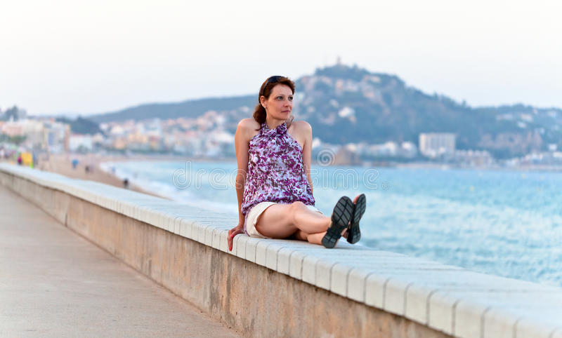 Middle age woman on a quay royalty free stock image