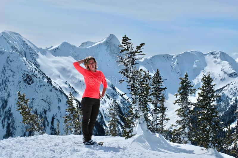 Middle age woman snowshoeing in mountains near Vancouver. stock image