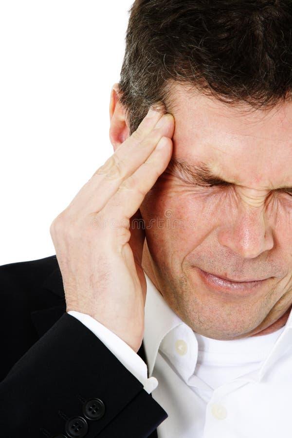Middle-aged человек терпит от головной боли стоковые изображения rf