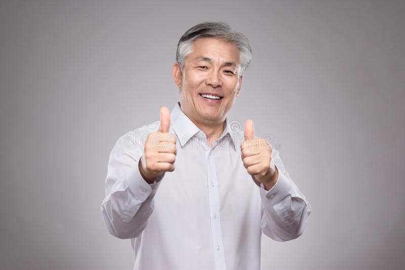 Download Middle Aged Asian Business Man Studio Portrait Photo - Stock Photo - Image: 83700196