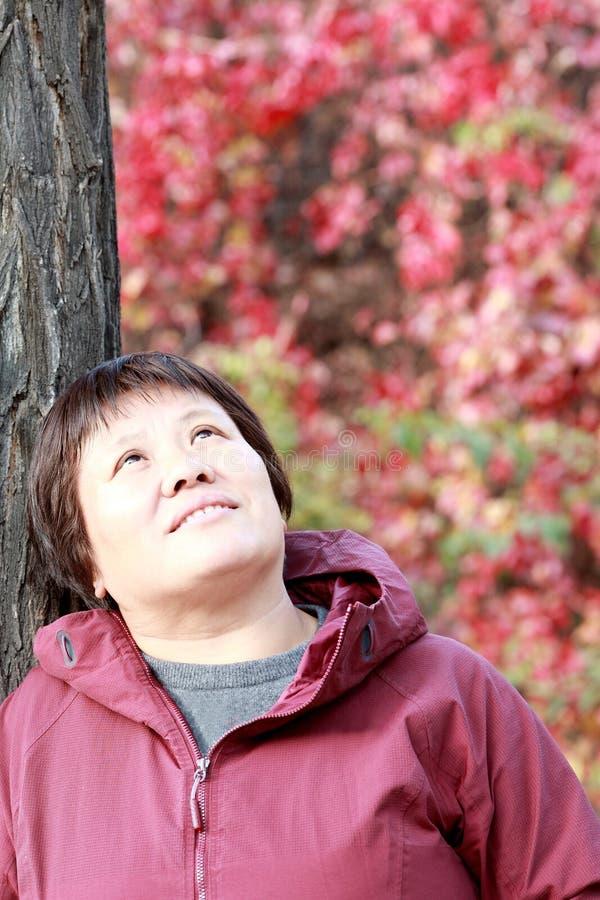 Middle aged Asian women enjoying autumn royalty free stock photo