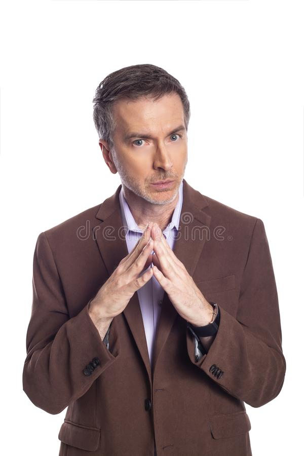 Middle Aged Businessman Looking Secretive stock photo