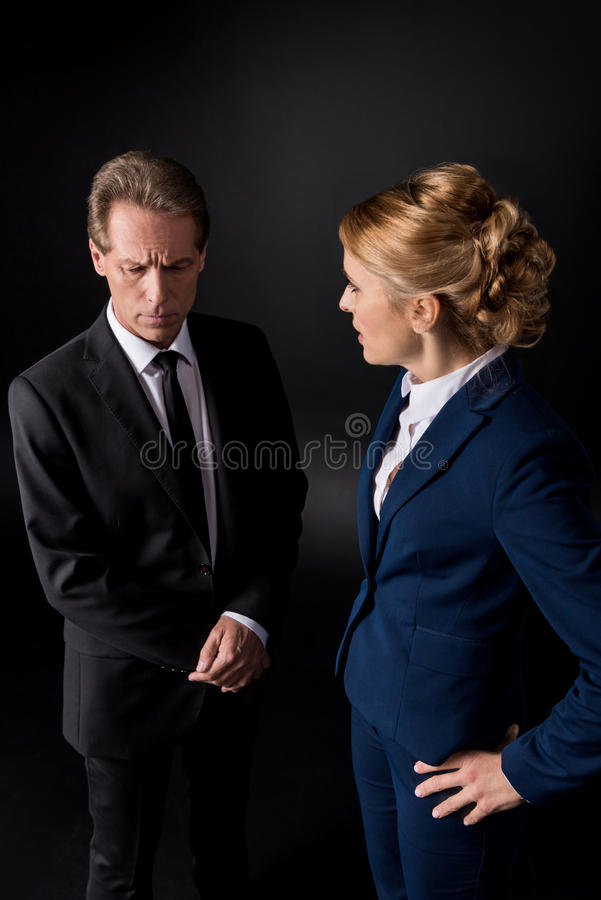 Middle aged business colleagues having conflict and quarreling royalty free stock image