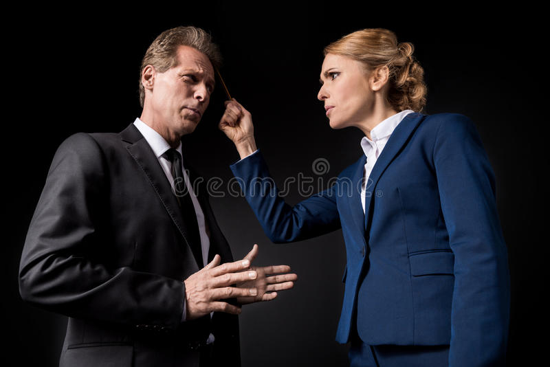 Middle aged business colleagues having conflict and quarreling stock photos