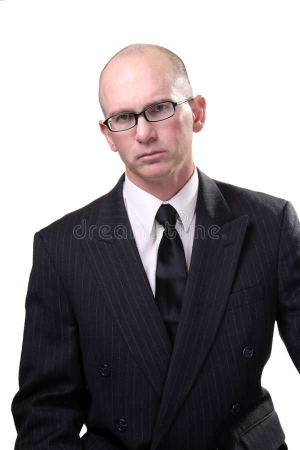Middle aged businessman. Half body portrait of serious middle aged businessman in pin stripe suit with glasses and bald head, white studio background royalty free stock photo