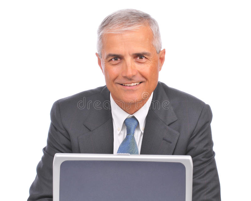 Middle aged Businessman Looking over laptop stock images