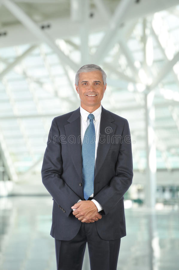 Download Middle Aged Businessman In Office Lobby Stock Photo - Image: 14672910