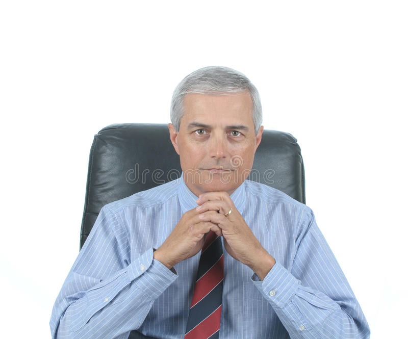 Download Middle Aged Businessman Seated At Desk Stock Photo - Image: 13601828