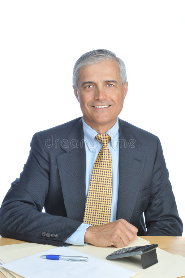 Download Middle Aged Businessman Seated At His Desk Stock Image - Image: 8479739