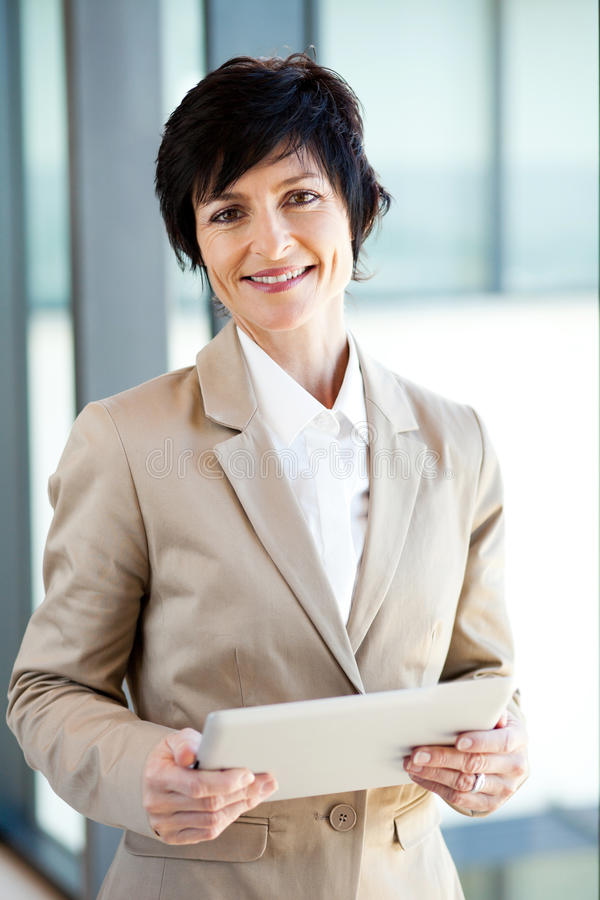 Middle aged businesswoman tablet computer royalty free stock images