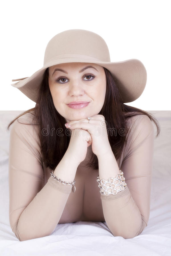 Middle-Aged Caucasian Woman See-Through Top Showing Cleavage. Older Caucasian Woman Reclining See-Through Top Cleavage royalty free stock photography